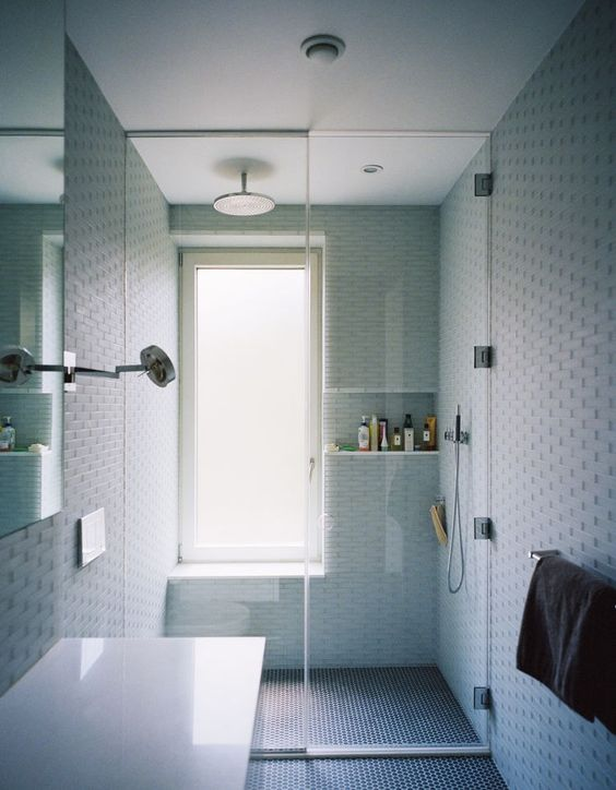 Another round of busy tile, but an interesting design where the window bench cutout also creates depth for a shower alcove. #ThisOldHouse shower inspiration via www.L-2-Design.com