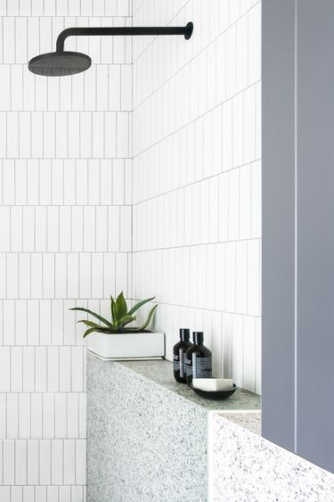 The simplicity of this shower alcove...or really a shelf...has me swooning. It looks so calm and peaceful. While there are a lot of details happening, it's all done so well that it doesn't look busy. #ThisOldHouse shower inspiration via www.L-2-Design.com