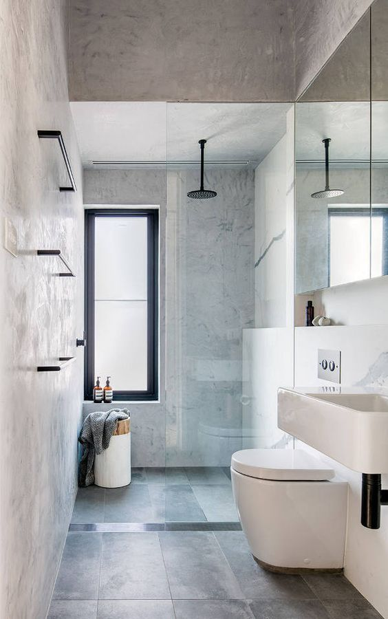 Another shelf design acting as a shower alcove. While the shelf continues into the vanity space, the line is broken by a straight, vertical wall for the glass divider. #ThisOldHouse shower inspiration via www.L-2-Design.com