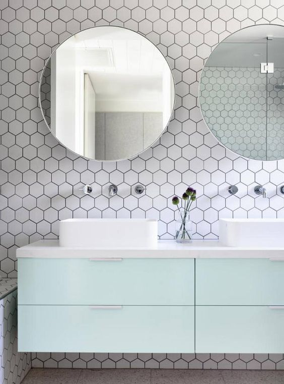 This bathroom counter and backsplash by Doherty Design Studio is the perfect mix of mid-century cute and modern flair. The honeycomb adds a geometric pop to the space without feeling overwhelming. #ThisOldHouse inspiration via www.L-2-Design.com