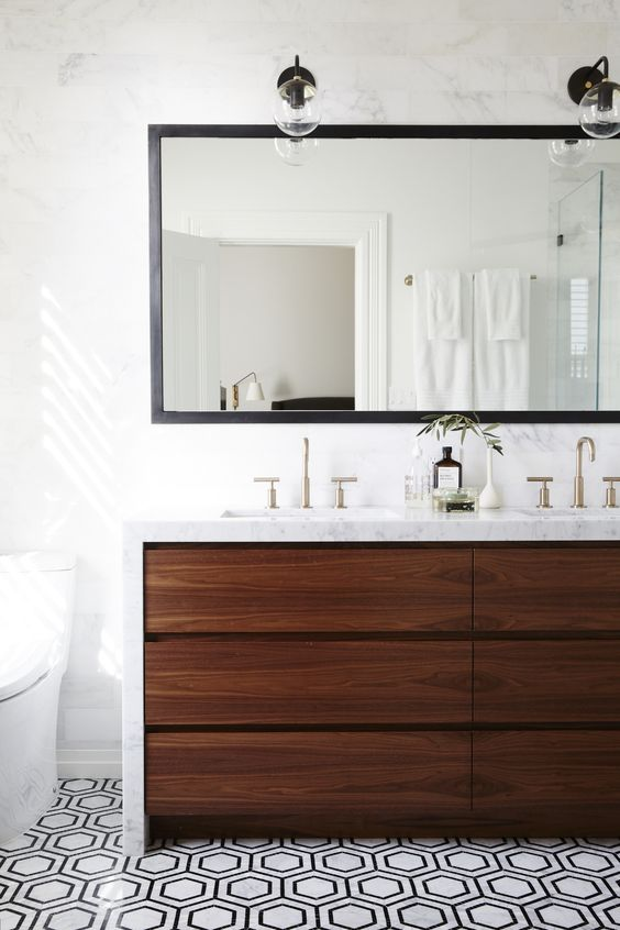 Because who wouldn't want an all marble bathroom counter and backsplash wall? This bathroom just oozes sophistication, from the simple overhead barbershop lighting to the simple faucet fixtures and waterfall counter. #ThisOldHouse inspiration via www.L-2-Design.com