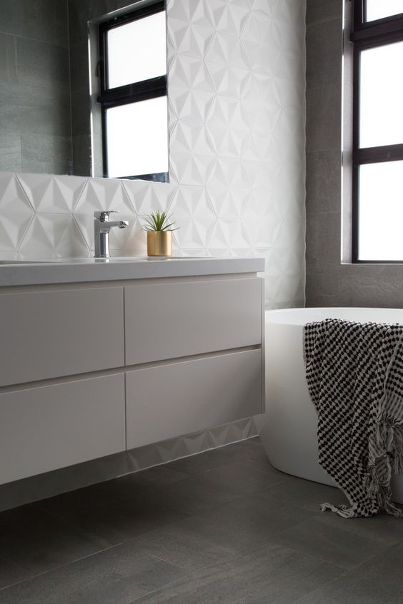 Speaking of texture, this bathroom counter may be a simple IKEA find, but they make sure to glam it up with some fantastic wall tile. This is a good picture, though, to show that corner details matter - especially with 3D tile. #ThisOldHouse inspiration via www.L-2-Design.com